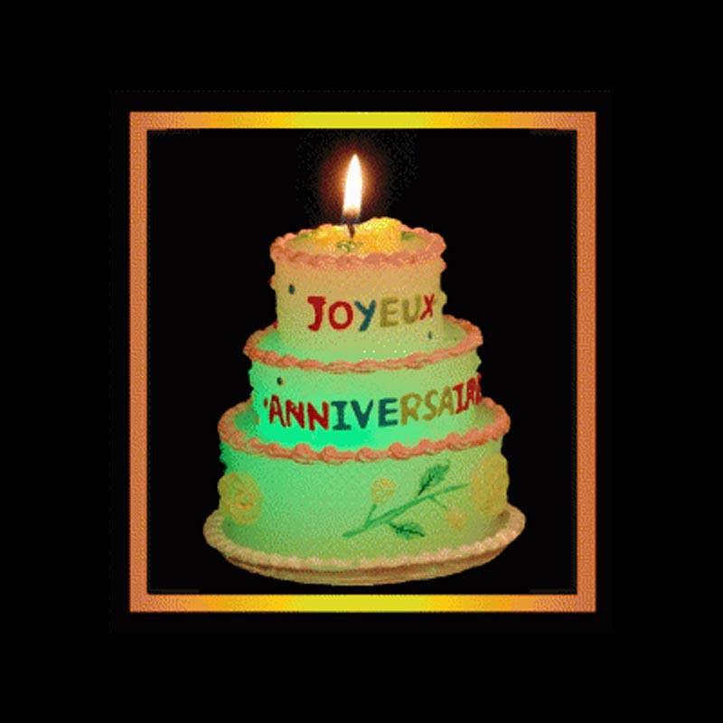 Le gâteau luminescent joyeux anniversaire